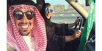 Saudi man teaching his wife how to drive.