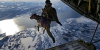 An Austrian Jagdkommando dropping from 10,000 ft with an explosives sniffing dog.