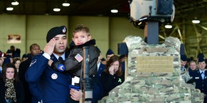 Child says final goodbye to his mother after the USAF Pavehawk crash in England last week.