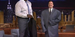 Jimmy Fallon wearing Shaq's jacket.