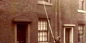 Before alarm clocks were affordable, 'knocker-ups' were used to wake people early in the morning. UK, around 1900