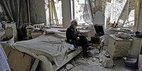 An Old man in Syria having a peaceful moment