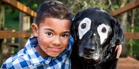 8-Year-Old Boy Embarrassed Of Vitiligo Meets Dog With Same Skin Condition