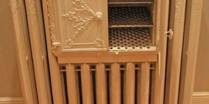 A Victorian radiator with a built in bread warmer.
