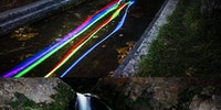 Glow sticks in a waterfall.