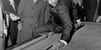 Martin Luther King Jr. prepping a behind-the-back shot at a pool hall in Chicago circa 1966