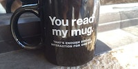 You read my mug.