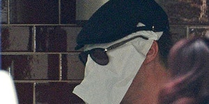 Benedict Cumberbatch hiding from paparazzi.