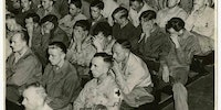 German soldiers in an American prison forced to watch a film of German concentration camp.