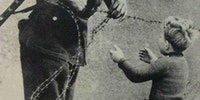 This moment.. An East German soldier ignores orders to let no one pass and helps a boy