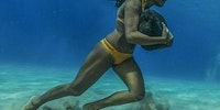 This Hawaiian surfer runs on the ocean floor with a 50 pound boulder, as a way to train to survive the massive surf waves.