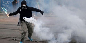 Returning a tear gas canister with a tennis racket