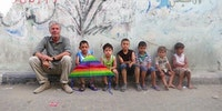 Anthony Bourdain with children in Ghaza