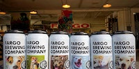 Fargo Brewing Company puts photos of rescue dogs on the cans to help them get adopted.