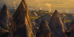 Hot air balloons rise up above Pigeon Valley in Turkey