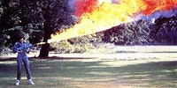 Sigorney Weaver testing the flamethrower for Alien on the lawn at Shepperton Studios