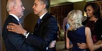 The Obamas and Bidens embracing