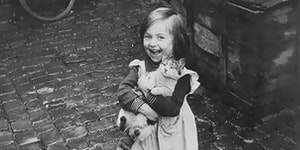 A girl and her cat, England, WWII., circish 1940