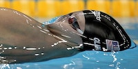 Fantastic shot of Olympic swimmer before breaking the surface tension of water
