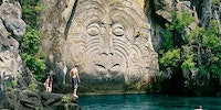 Maori rock carvings at Mine Bay, New Zealand