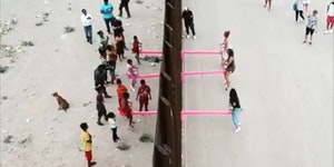 A gaggle of artists installed a see saw at the border wall so that US and Mexican kids can play together
