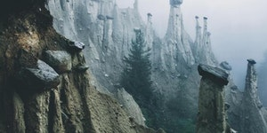 Rocks perched on eroded pillars of dirt in the Italian Alps