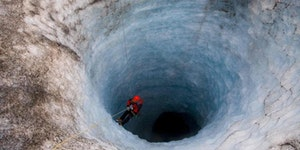 Check out that man in a gigantic icehole.