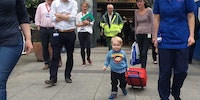 Elliott leaving Great Ormond Street Hospital after his heart transplant.