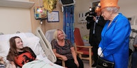 Queen Elizabeth II visits Manchester victims
