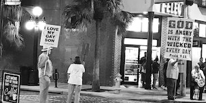 His sign may be smaller, but his message is much bigger.