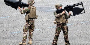 French soldiers shouldering anti-drone weaponry.