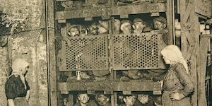 Belgium coal miners in a shaft elevator.
