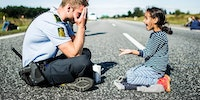 Danish police officer versus Syrian refugee